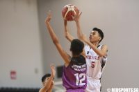 Brenndon Ariffin (#5) of North Vista Secondary shoots against Robin (#12) of Jurong West Secondary. (Photo © Lee Jian Wei/Red Sports)