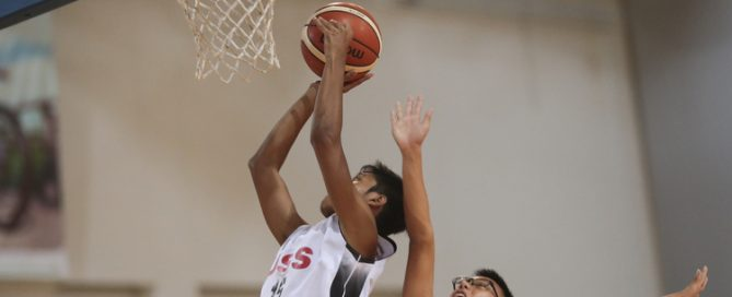 Nurhairie Nazief (#15) of Unity Secondary shoots against (#6) of Dunman High. (Photo © Lee Jian Wei/Red Sports)