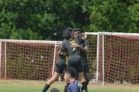 QTSS players celebrate Muhammad Fadil's (QTSS #8) goal. (Photo 1 © REDintern Nathiyaah Sakhimogan)