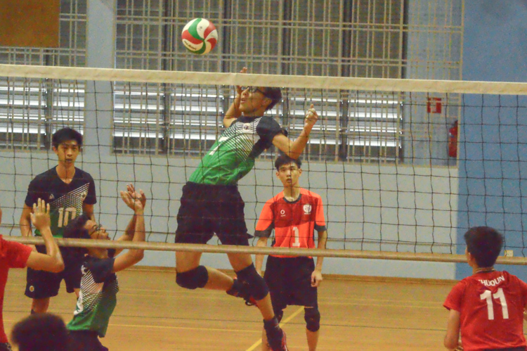 Punggol Secondary player (#7) attempts to spike past the SQS blockers. (Photo 6 © REDintern Nathiyaah Sakthimogan)