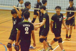 XMS players celebrate winning a point after a rally. (Photo 3 © REDintern Nathiyaah Sakthimogan)