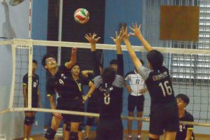 XMS player (#9) attempts to spike over the GMS blockers. (Photo 10 © REDintern Nathiyaah Sakthimogan)