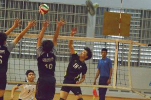 XMS player (#18) with the hard spike over the GMS blockers. (Photo 11 © REDintern Nathiyaah Sakthimogan)
