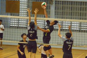 XMS spiker (#15) rises high to spike hard past the GMS blocker. (Photo 13 © REDintern Nathiyaah Sakthimogan)