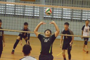 XMS player (#15) sets up his teammate for the spike. (Photo 2 © REDintern Nathiyaah Sakthimogan)