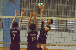 XMS player (#2) attempts to spike past the GMS blockers.  (Photo 8 © REDintern Nathiyaah Sakthimogan)