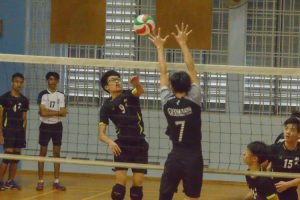 XMS player (#9) with the hard spike. (Photo 9 © REDintern Nathiyaah Sakthimogan)