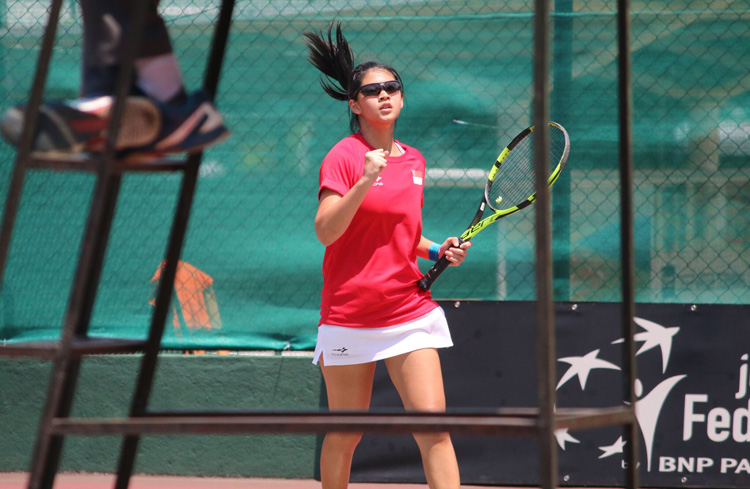 Joelle Goh clenching her fist during a match in the 2018 ITF Junior Fed Cup. (Photo 4 by Red Sports reader Warren Choo)