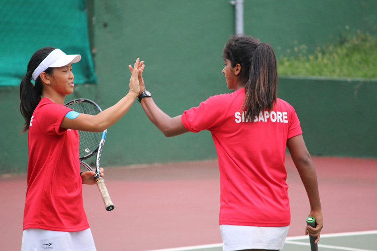 Trisha Mulani high fiving her partner, Deanne Choo, during the 2018 ITF Junior Fed Cup. (Photo 4  by Red Sports reader Warren Choo)