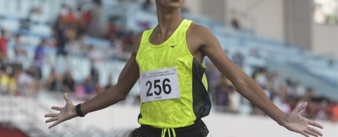 Syed Hussein Aljunied (#256) of Victoria Junior College celebrating his win during the A Division boys' 1500m race. He finished with a time of 04:16.41s.. (Photo © Stefanus Ian).