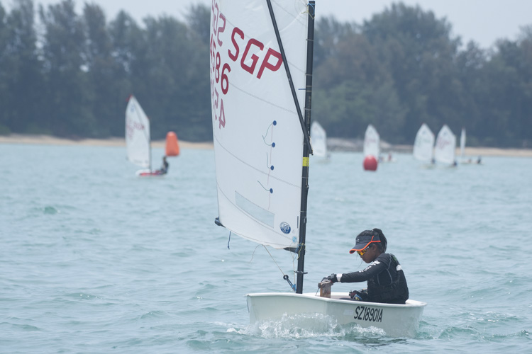Joelle Lio of Raffles Girls' School  (#4586) came in second with a score of 18 points in the C Division Girls' Optimist Sailing Championships. (Photo  © Stefanus Ian/Red Sports)