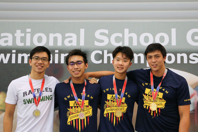 Medallists of the Boys 50m Butterfly A Division posing after the race. Ong Jung Yi (second from left) of ACS(I) led the field to win gold with a time of 24.88s. (Photo © Daniel Yeo/Red Sports)
