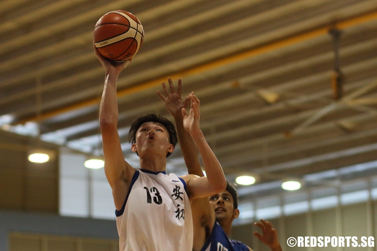 Xavier Ng (AJC #13) rises for a lay-up on his way to a 16-point performance.