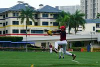 Hwa Chong's ace pitcher Aloysius (HCI #08) winding up his first pitch of the match. (Photo 1© REDintern Pang Chin Yee)
