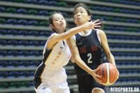 Rachel Tan (NJC #2) attacks the basket against Jurong on her way to a 19-point performance. (Photo 1 © Dylan Chua/Red Sports)