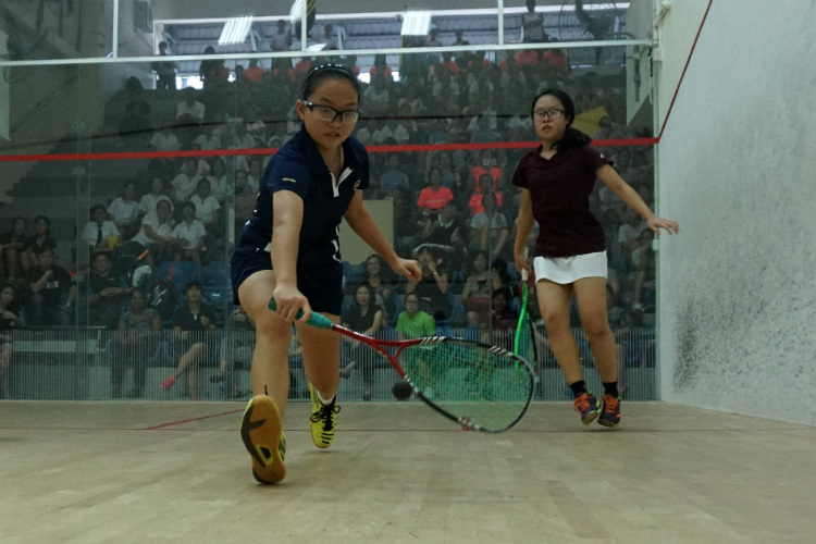 Michelle Lai (front) of MGS going in for a backhand shot against Lim Yu Xuan (back) of SCGS. (Photo 4 © REDintern Pang Chin Yee)