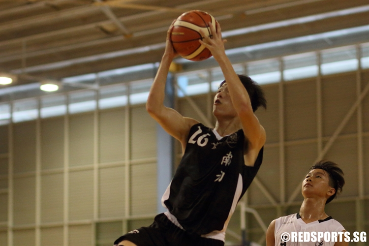 Wilbur Tan (NYJC #26) elevates for a lay-up in transition. He dropped a game-high 22 points in the victory. (Photo  © Chan Hua Zheng/Red Sports)