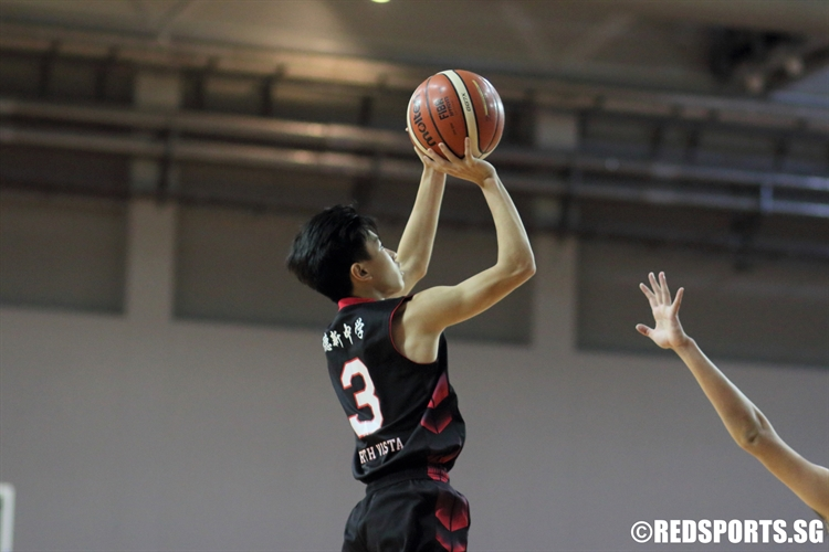 Chan Qi Feng (NV #3) rises for a baseline jumper over the defense. (Photo © Chan Hua Zheng/Red Sports)