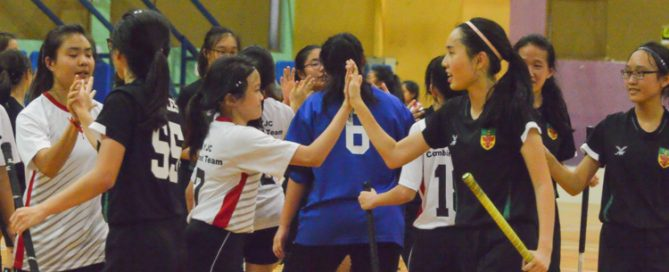 Both teams come together at the end of the match to exchange handshakes. (Photo 1 © REDintern Nathiyaah Sakthimogan)