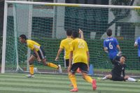 Muhammad Haikel (VJC #11) runs away celebrating his first goal of the game. (Photo 1 © REDintern Nathiyaah Sakthimogan)