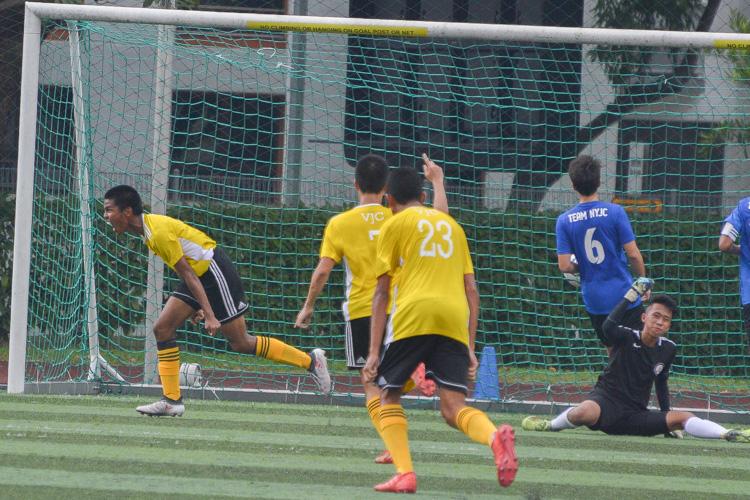 Muhammad Haikel (VJC #11) runs away celebrating his first goal of the game. (Photo 1 © REDintern Nathiyaah Sakthimogan)