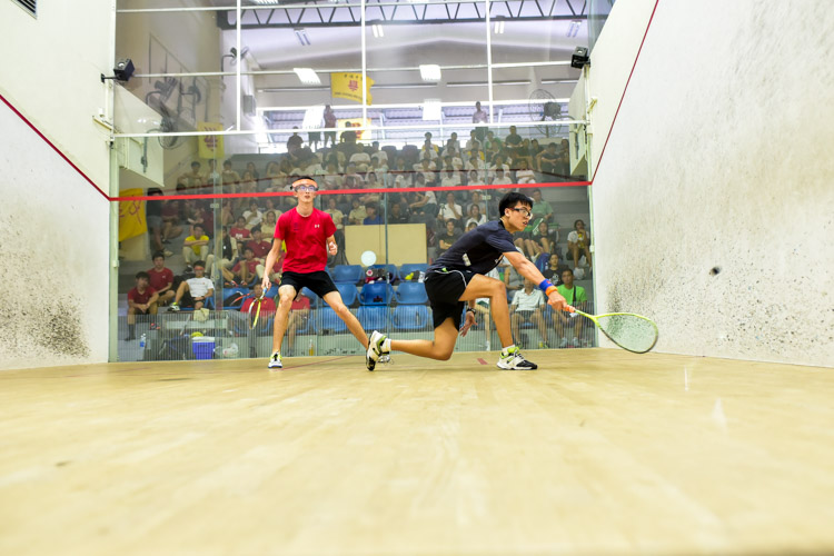 Tan Izhi of RI in action during his match against HCI's Lorcan Timothy Murphy. (Photo © Stefanus Ian/Red Sports)