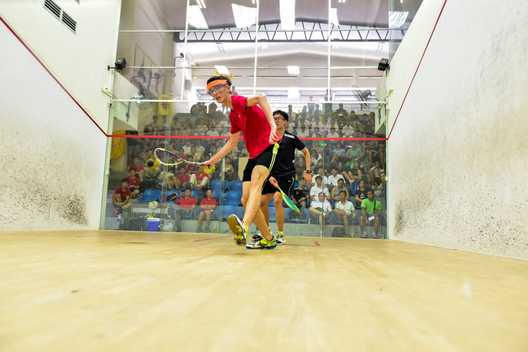 HCI's Lorcan Timothy Murphy in action during his match against RI's Tan Izhi. (Photo © Stefanus Ian/Red Sports)
