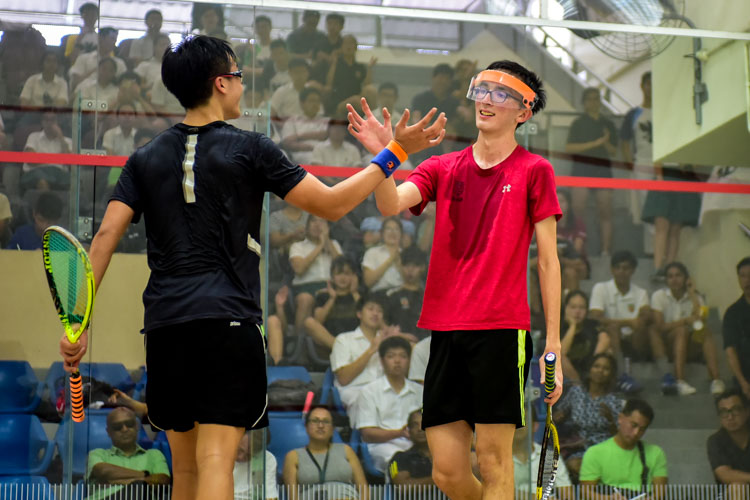 Tan Izhi of RI and HCI's Lorcan Timothy Murphy shaking hands with each other after their match. (Photo © Stefanus Ian/Red Sports)