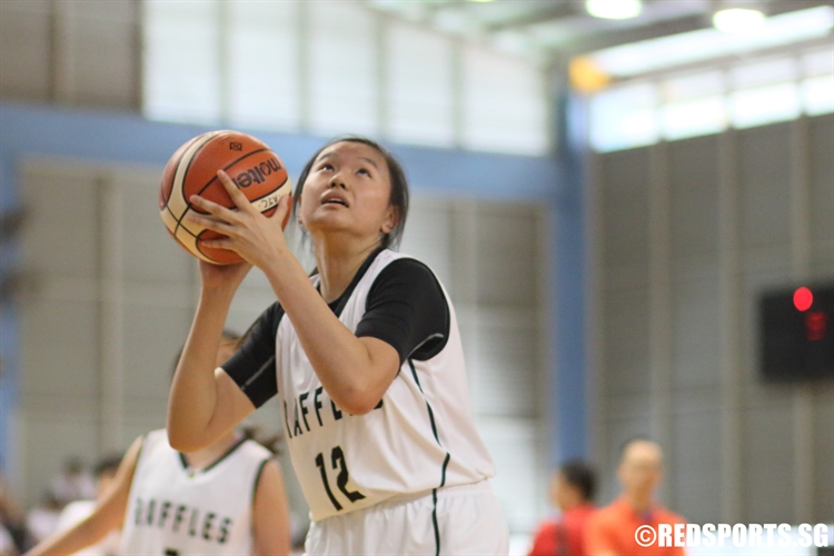 Tan Kang Yi (RI #12) gets free for an open look under the basket. She bagged a game-high 10 points against Dunman High. (Photo 1 © Dylan Chua/Red Sports)