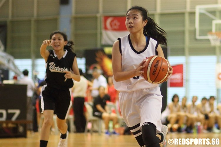 Ivon Kong (HCI #8) shakes free of her defender on a drive to the basket. The HCI player scored a game-high 24 points against VJC. (Photo 1 © Dylan Chua/Red Sports)