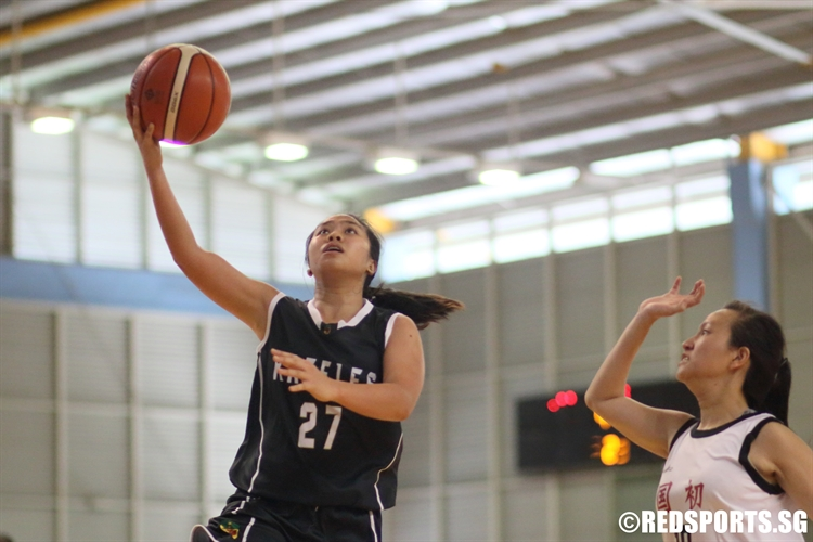 Patricia Orenza (RI #27) lays the ball up for two of her game-high 14 points against NJC. (Photo 1 © Dylan Chua/Red Sports)