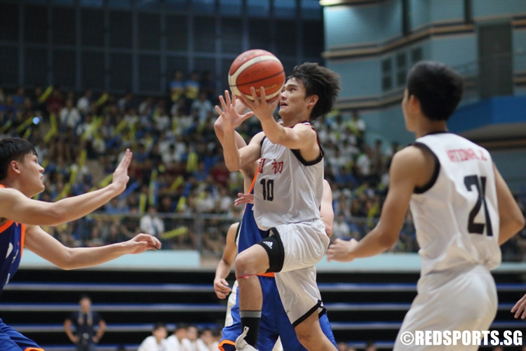 Ian Tay (NJC #10) soars through the defense for a lay-up. He finished with 10 points. (Photo © Chan Hua Zheng/Red Sports)