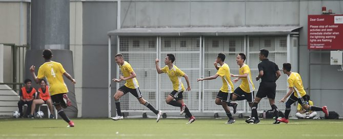 Victoria Junior College celebrates after Marcus Tang (#5) scored in the winning goal in the 80th minute. (Photo © Lee Jian Wei/Red Sports)