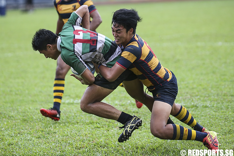 Ian Teh (#6) of ACS (Independent) tackles Jediel Yew (#13) of Raffles Institution. (Photo © Lee Jian Wei/Red Sports)