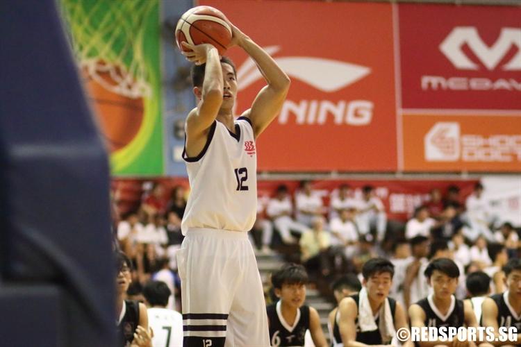 Guan Xiao (HCI #12) rises for a corner three. (Photo  © Chan Hua Zheng/Red Sports)