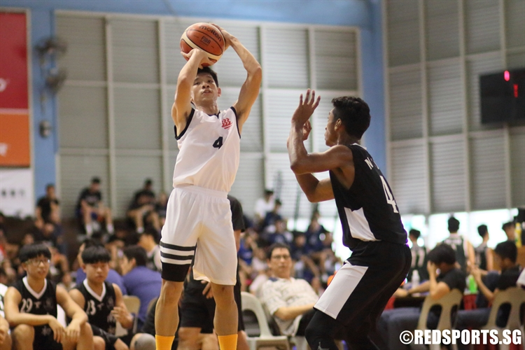 Chua Qi Wei (HCI #4)  pulls up for a jump-shot. He finished with a team-high 10 points. (Photo  © Chan Hua Zheng/Red Sports)