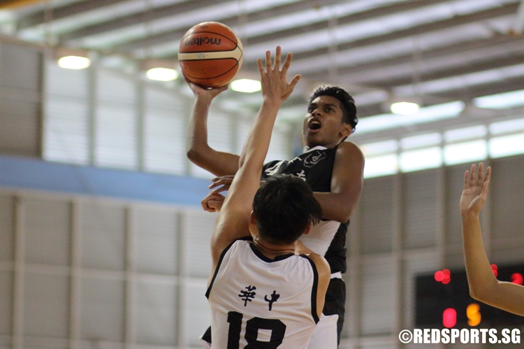 Avinesh (NYJC #4) draws contact as he goes for a lay-up. He finished with a game-high 16 points in the victory. (Photo  © Chan Hua Zheng/Red Sports)