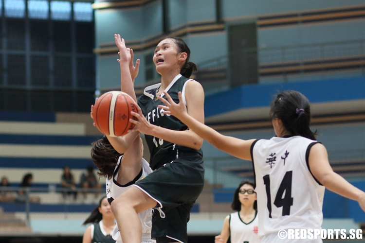 Shannon Tiong (RI #15) rises for a lay-up to score two of her 13 points. (Photo 1 © Dylan Chua/Red Sports)