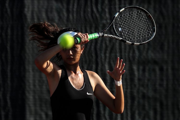 Laura Chan of Raffles Institution in action during her doubles match against Anglo-Chinese Junior College.