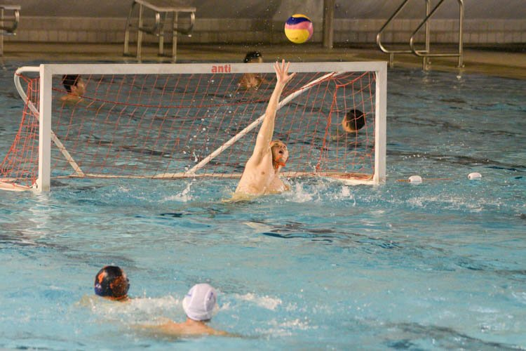 Bryan Santoso (NUS #1) making a save during the match between NUS and NYP