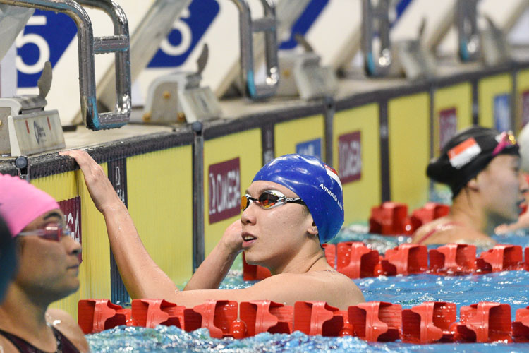 Amanda Lim looking at the results after the women's 50m freestyle final at the 14th Singapore National Swimming Championships 2018. She stopped the clock at 25.38s to win the gold medal. (Photo 1 © Stefanus Ian/Red Sports)