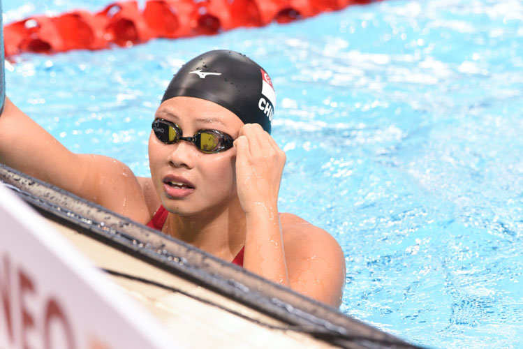 Christie Chue looking at the results after one of the women's 50m breaststroke races at the 14th Singapore National Swimming Championships 2018. She came in second in the final with a time of 32.44s. (Photo 1 © Stefanus Ian/Red Sports)