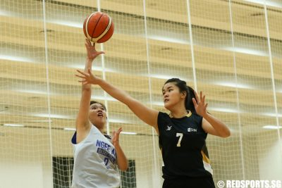 Amelia Wong (#2) of Ngee Ann Polytechnic shoots against (#7) of Singapore Institute of Management. (Photo © Lee Jian Wei/Red Sports)