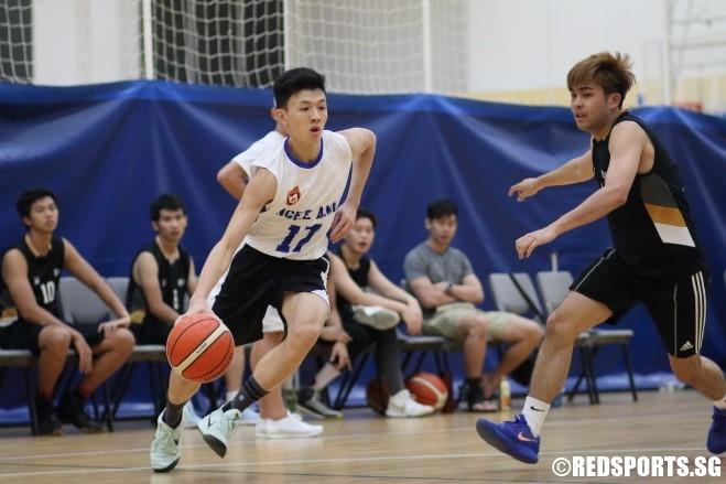 Hsu Yao (NP #17) slashes baseline against the defense. (Photo  © Chan Hua Zheng/Red Sports)