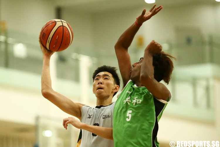 (#9) of Singapore Institute of Management shoots a layup against Prem Haran (#5) of Republic Polytechnic. (Photo © Lee Jian Wei/Red Sports)