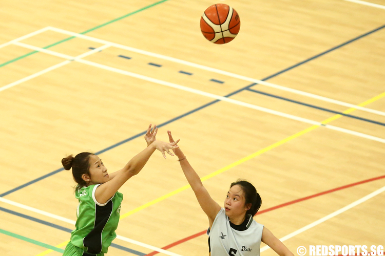 Soh Hui Ting (#8) of Republic Polytechnic shoots against (#5) of Singapore Institute of Management. (Photo © Lee Jian Wei/Red Sports)