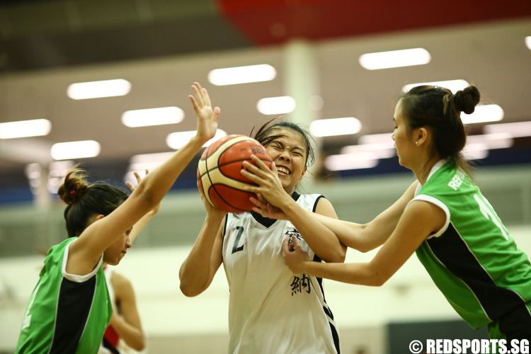 Joanne (#2) of Temasek Polytechnic drives against Sheryl Koh (#2) and Chia Siu Wei (#11) of Republic Polytechnic. (Photo © Lee Jian Wei/Red Sports)