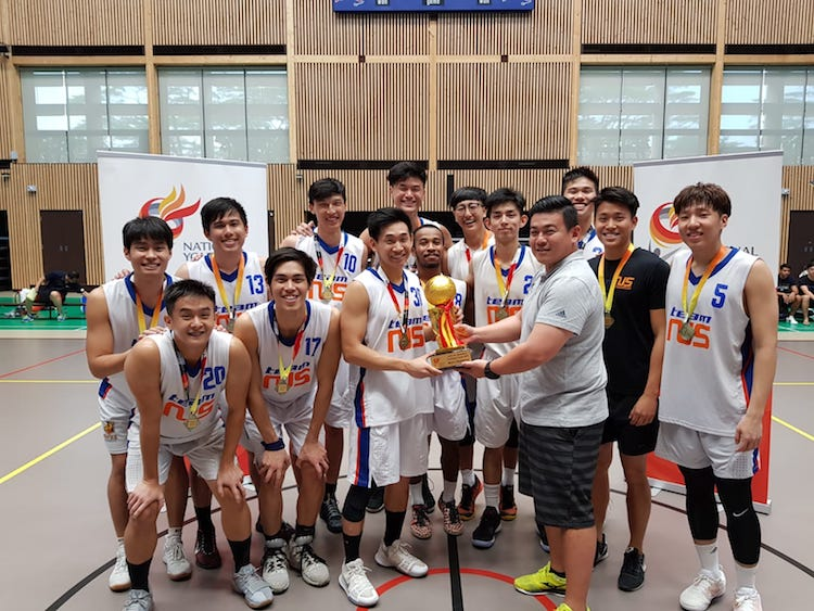 Team NUS posing with the NYSI Basketball League trophy after their win against NTU. (Photo 1 from reader)