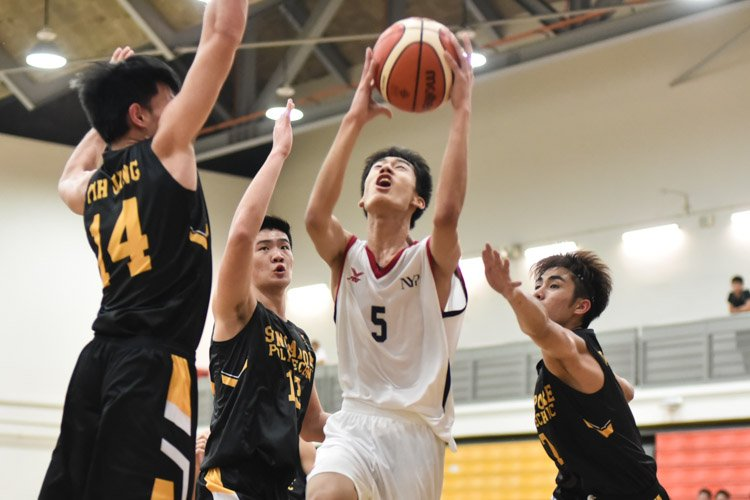 Nanyang Polytechnic's Wong Teng Yew (NYP #5) being closely guarded as he attempts a lay up.  (Photo 1 © Stefanus Ian/Red Sports)