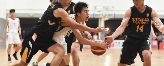 Nanyang Polytechnic's Wong Teng Yew (NYP #5) being fouled as he drives towards the basket. He would later convert one out of two free throws to put the game beyond the reach of Singapore Polytechnic. (Photo 1 © Stefanus Ian/Red Sports)
